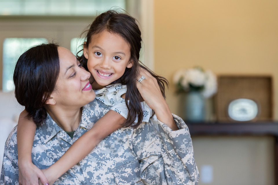 Cheerful military mom is reunited with adorable daughter