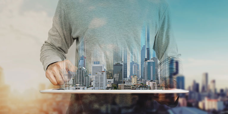 A man holding a model of a metropolitan city in his hands.