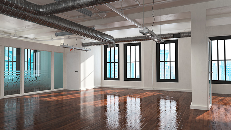 Renovated open office space in an older building.