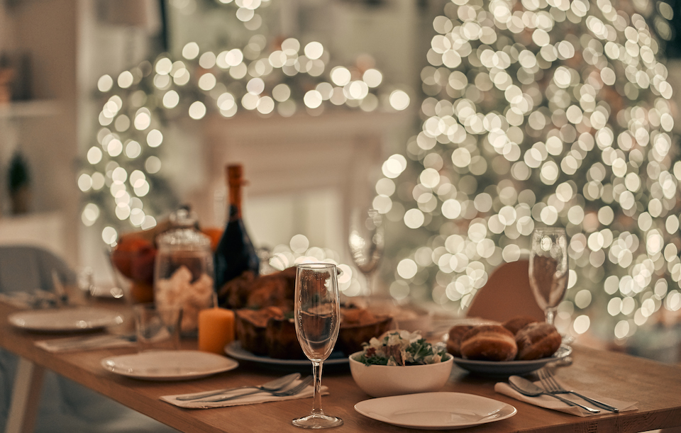 The festive table on the christmas tree background