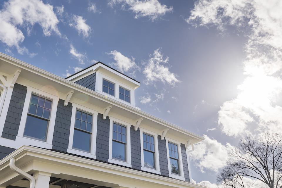Sunny day illuminating a house with many windows